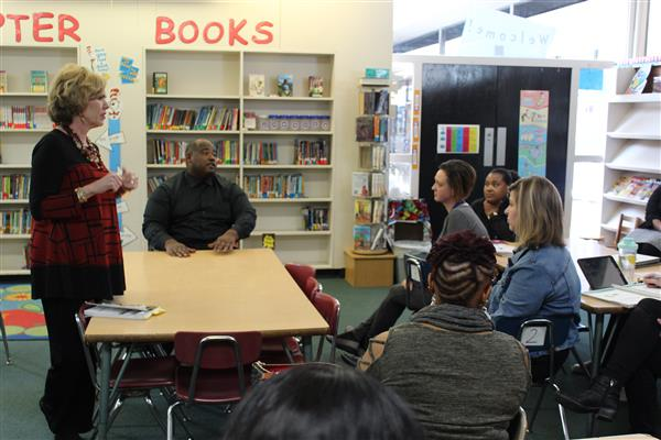 Donna Porter, left, and DJ Batiste, right, talk with teachers at Crestwood Elementary on Monday, Ja